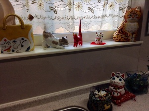 After: Cat themed pieces decorate the sill