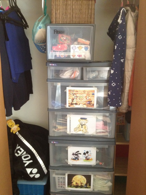 "Top left are school uniform and thingies, bottom left are ECA sporting gear, rest of daily wear are sorted into drawers, jackets are hung to the right above, with a whole row of empty shelves to hold ""stuff to come""."